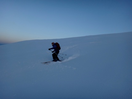 Deziree enjoying the powder descending down the side on Corie an Lochan